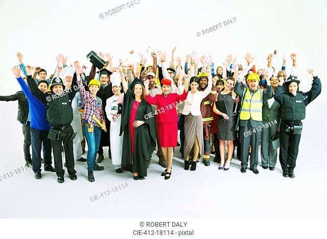Portrait of diverse cheering crowd