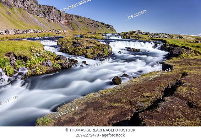 Raging river and waterfalls along Route 1 Fjaorfargigljufur Iceland