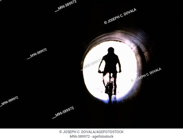 Bike rider in culvert