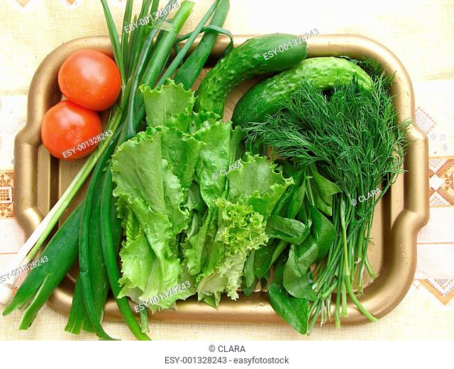 greenery and vegetables on the tray