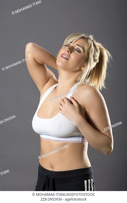 Woman wearing sports bra with back pain tired from exercise