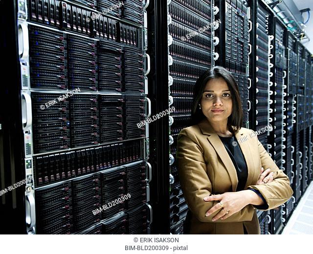 Indian businesswoman standing in server room