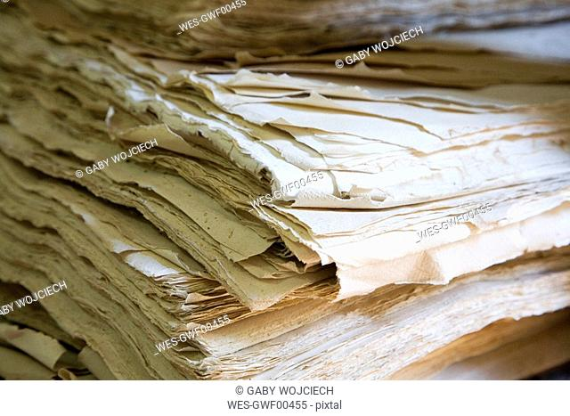 Stack of hand made paper, close-up