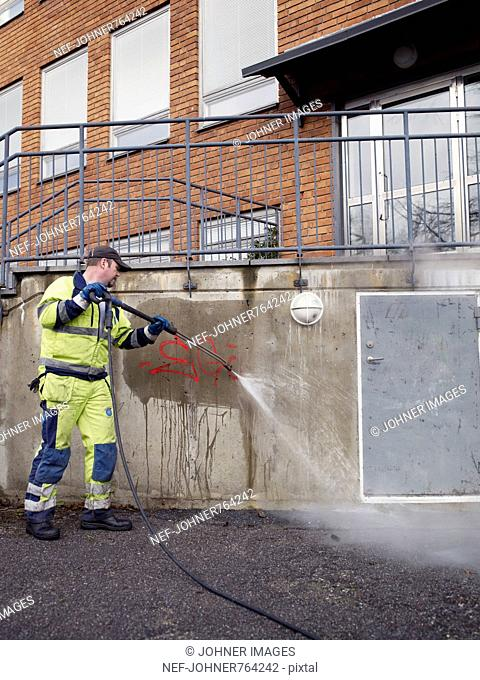 A man removing graffiti, Sweden