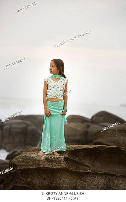 Girl standing on large rocks