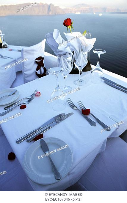 Table set for dinner at a resort with the view of the sea