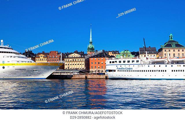 Sweden, Stockholm, The Old Town - Boats moored along the quayside