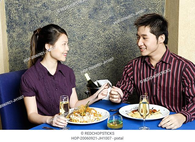Young couple sitting at a table in a restaurant