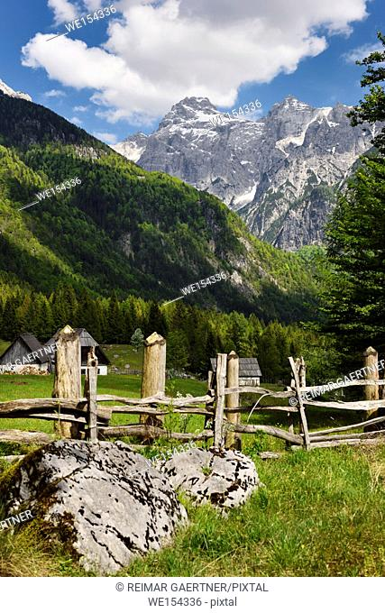 Snow capped Razor Peak in Triglav National Park Julian Alps from farmstead in Zadnja Trenta Valley Slovenia in Spring