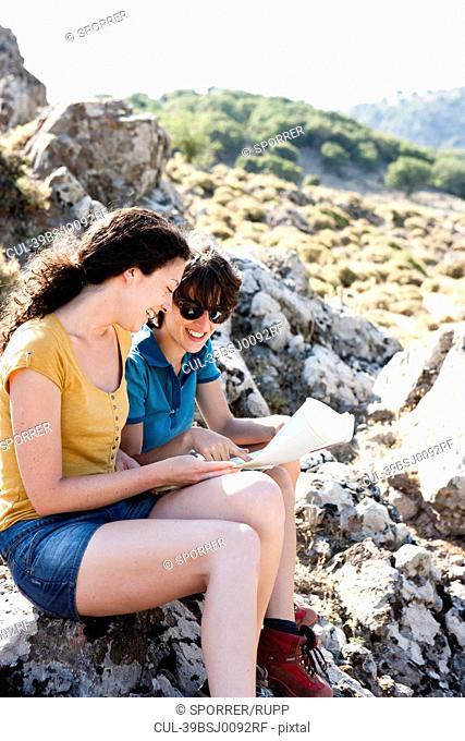 Women reading map outdoors