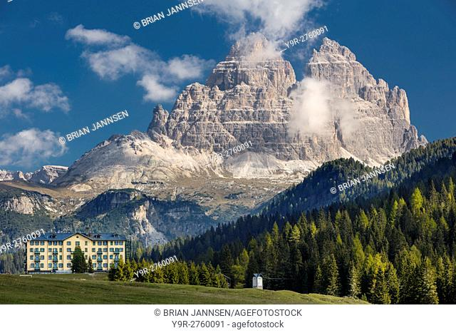 The Tre Cime di Lavaredo towers over Opera Diocesana San Bernardo Degli Uberti Istituto Pio XII - a private hospital on Lago Misurina, Belluna, Italy