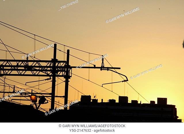 overhead train power lines at sunset in rome italy