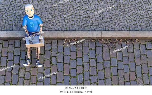 Robot sitting on curb using laptop, 3d rendering