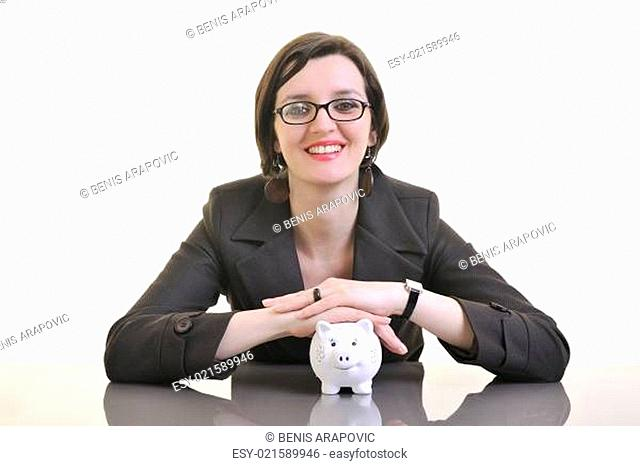 business woman putting money coins in piggy bank