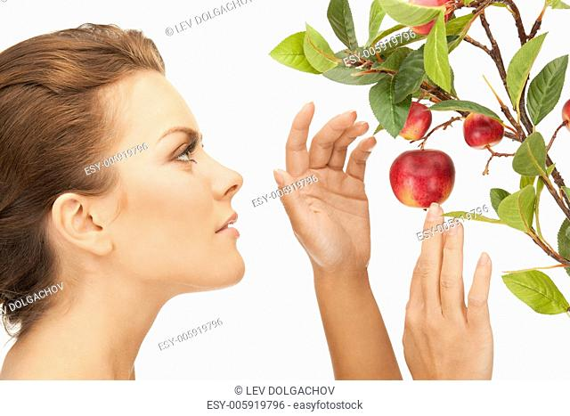 picture of lovely woman with apple twig