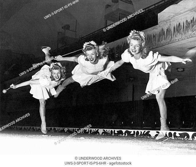 San Francisco, California: August, 1942.Betty Atkinson, Ice Follies skater, does an Arabian Cartwheel that is caught in a triple exposure by the photographer at...