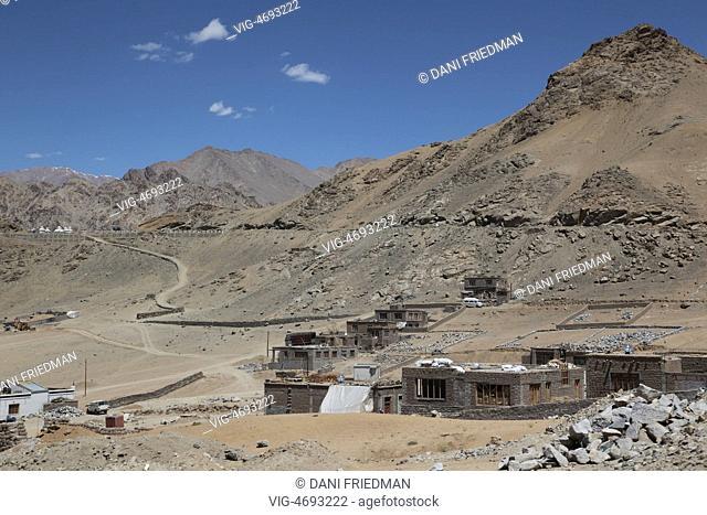 Newly built homes and homes under construction near Changspa, Leh District, Ladakh, Jammu and Kashmir, India. - CHANGSPA, LADAKH, India, 09/07/2014