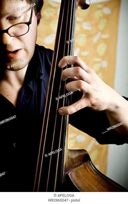 Cropped image of man playing bass
