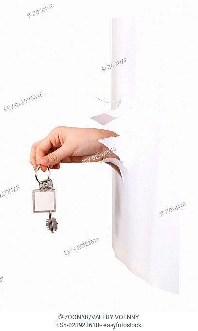side view of hand holds the keyring through a hole