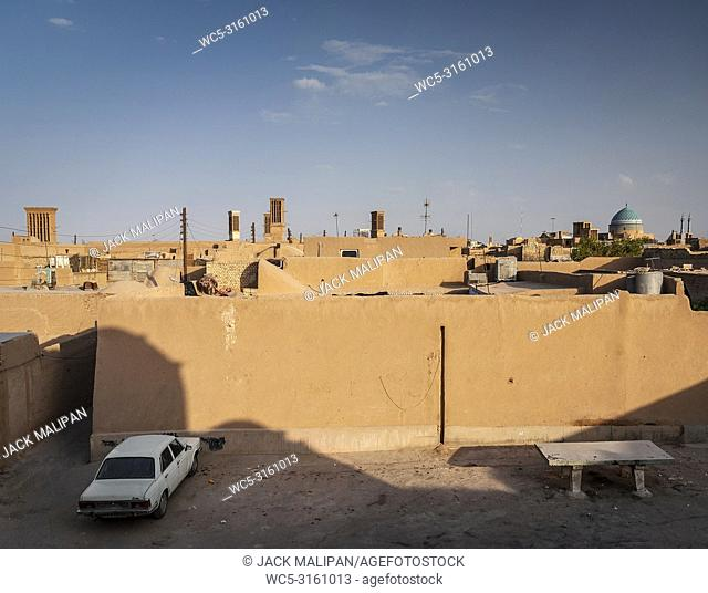 downtown rooftops wind towers and landscape view of yazd city old town in iran