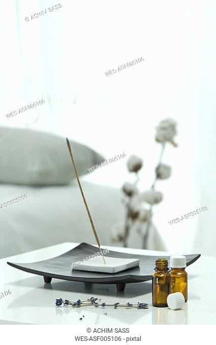 Aroma sticks with aroma oil and lavender flower on table, close up