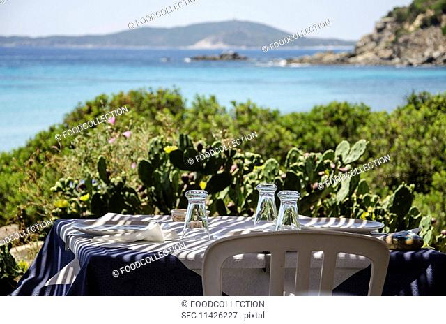 Table laid outside with a sea view
