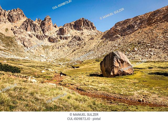 Landscape with boulder in mountain valley, Nahuel Huapi National Park, Rio Negro, Argentina