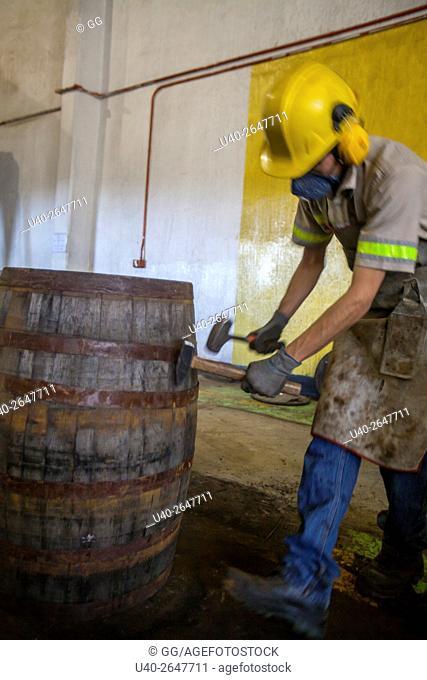 Guatemala, Quetzaltenango, worker making ageing barrels