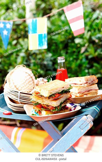 Stack of schiacciata sandwiches on desk chair