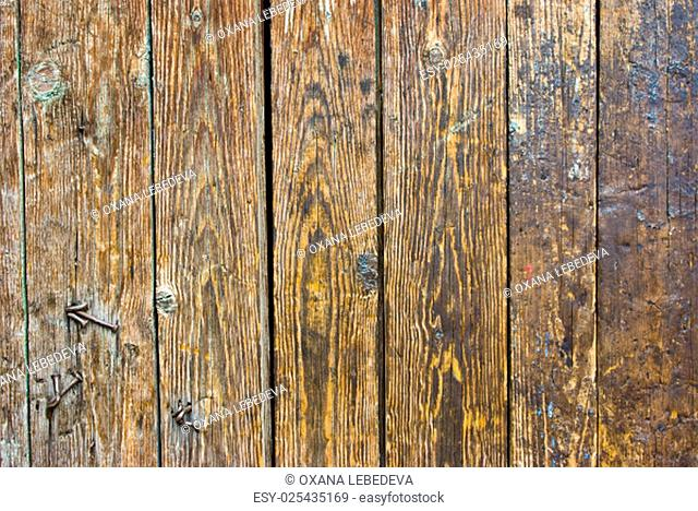 Old background of weathered dark painted wood