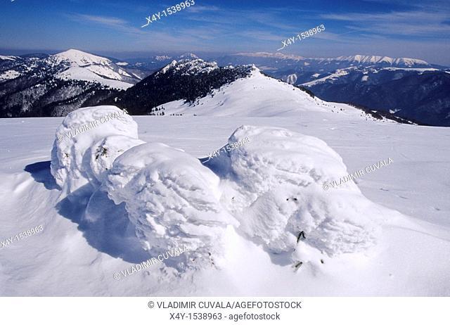 Winter scenery in the Velka Fatra mountains, Slovakia  View from the summit of Ploska towards Nizke Tatry mountains