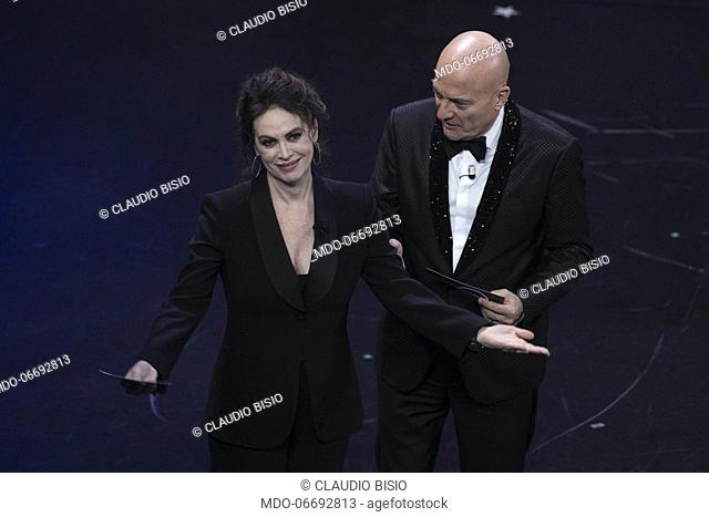 Italian host and comedian Claudio Bisio and Italian actress Elena Sofia Ricci during the fifth and last evening of the 69th Sanremo Music Festival