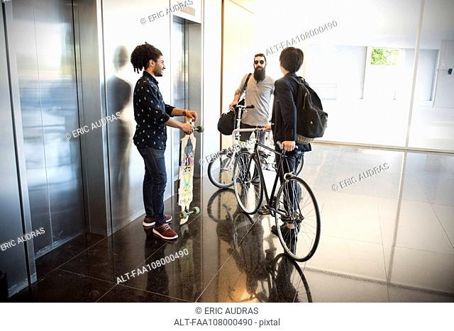 Colleagues chatting in lobby