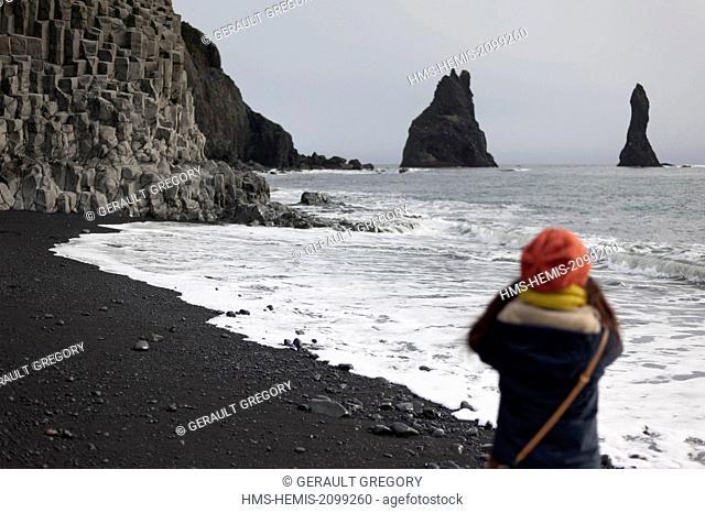Iceland Sudurland, Reynisfjara, black sand beach, Vik needles and columnar basalt