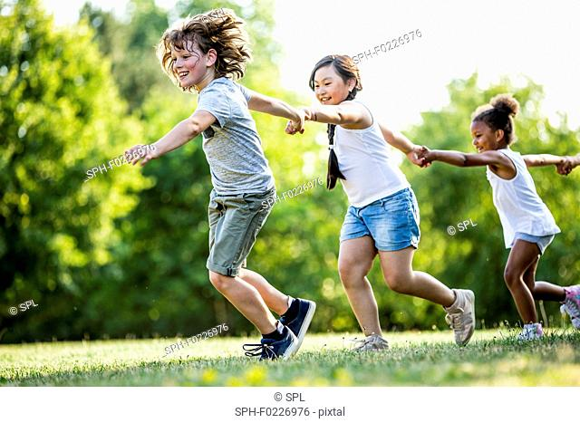 Children holding hands and running