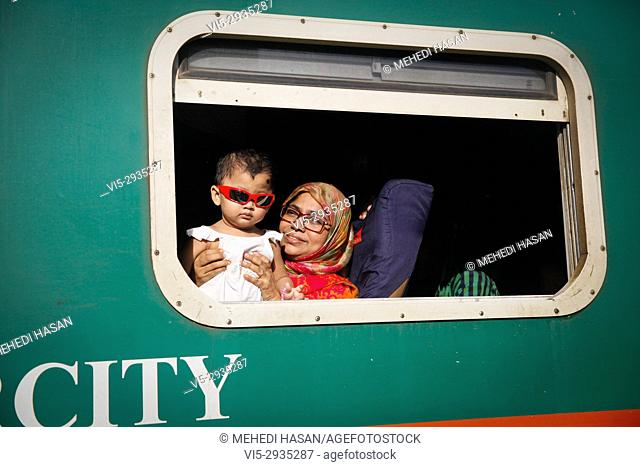 Bangladeshis cram onto a train as they travel home to be with their families ahead of the Muslim festival of Eid al Fitr, in Dhaka