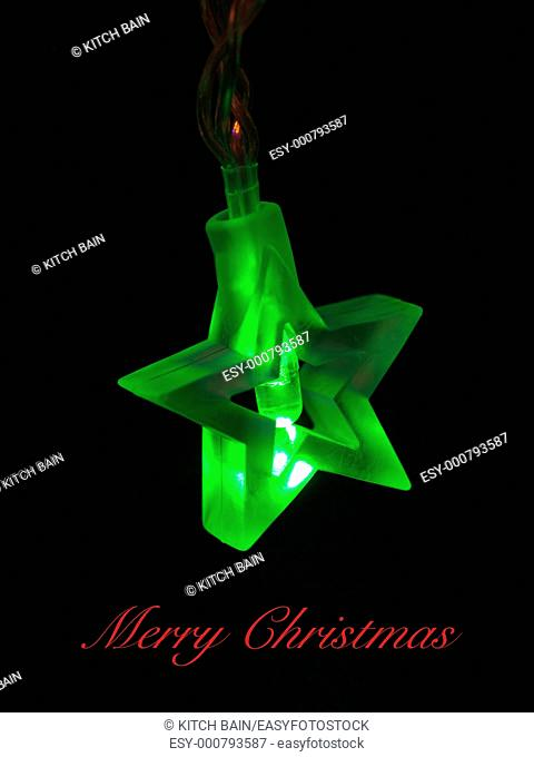 Christmas tree lights isolated against a black background