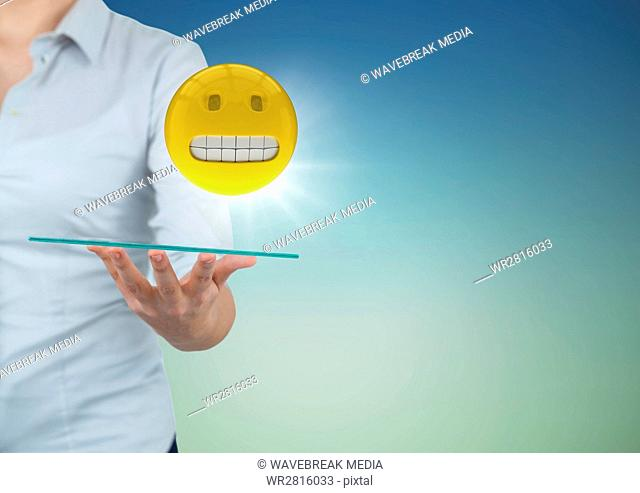 Business woman mid section with tablet and emoji and flare against blue green background