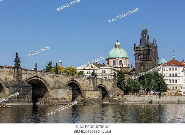 Buildings and bridge over Prague waterfront, Prague, Czech Republic