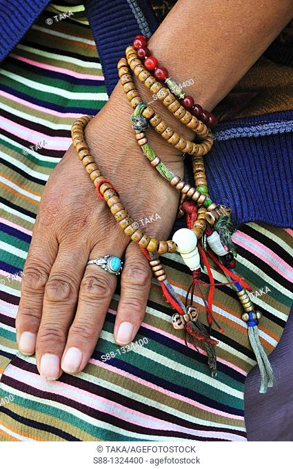 Rosary of the Tibetan woman's hand