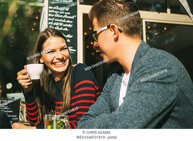 Couple in a coffee shop having fun