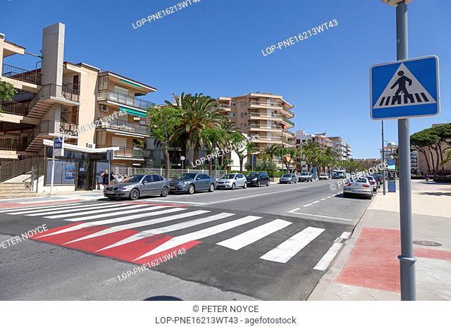 Spain, Catalonia, La Pineda. Pedestrian crossing to the promenade seafront at La Pineda