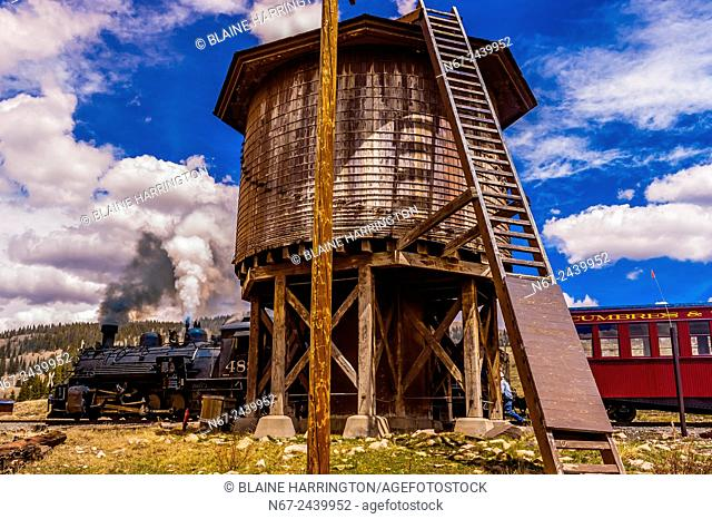 Cumbres & Toltec Scenic Railroad train takes on water for the boiler of the steam engine on the 64 mile run between Antonito, Colorado and Chama, New Mexico