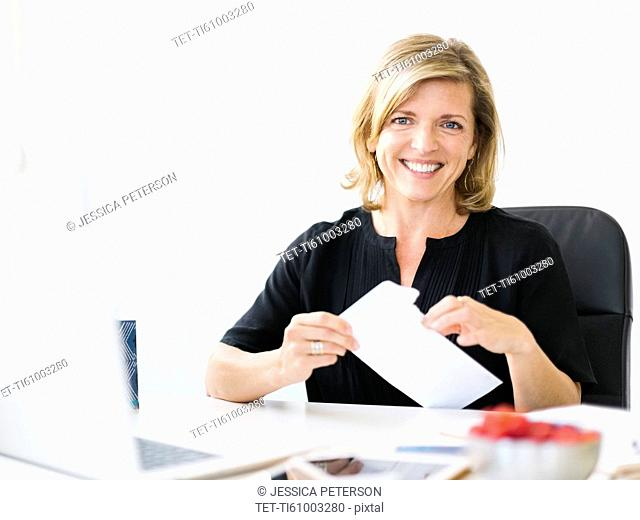 Portrait of Mature woman opening letter