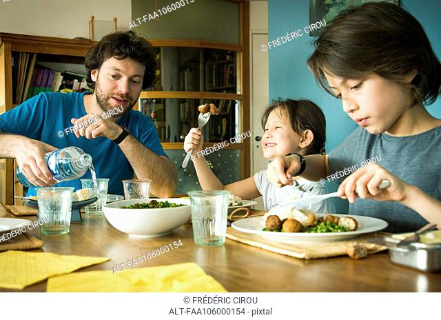 Family eating dinner together