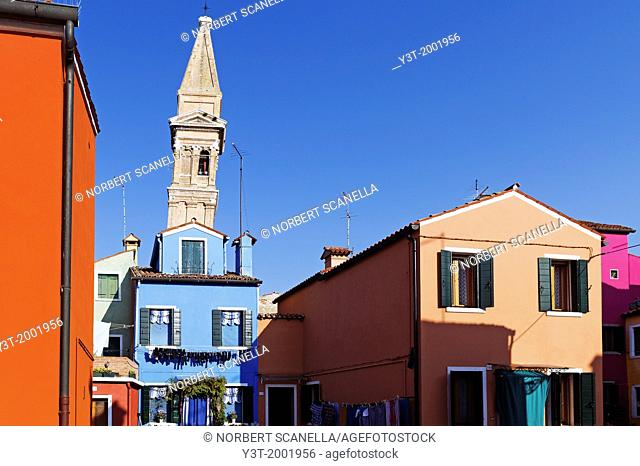 Europe, Italy, Veneto, Burano, classified as World Heritage by UNESCO. The colorful houses of the village of Burano and the leaning tower
