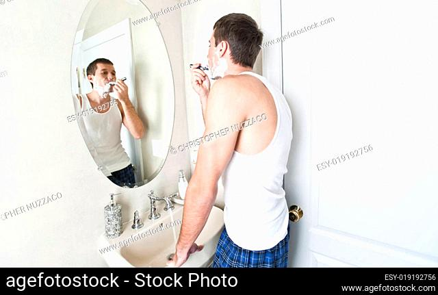 Young Man in Bathroom Shaving
