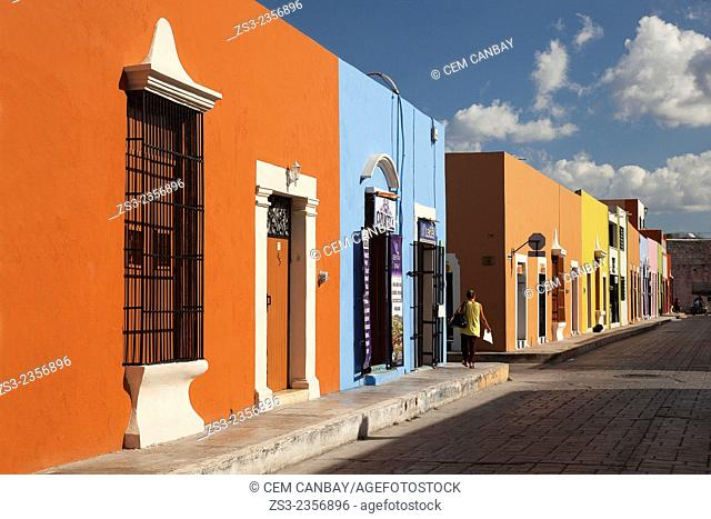 Woman walking in the street at the historic center of Campeche, Campeche Region, Yucatan, Mexico, Central America