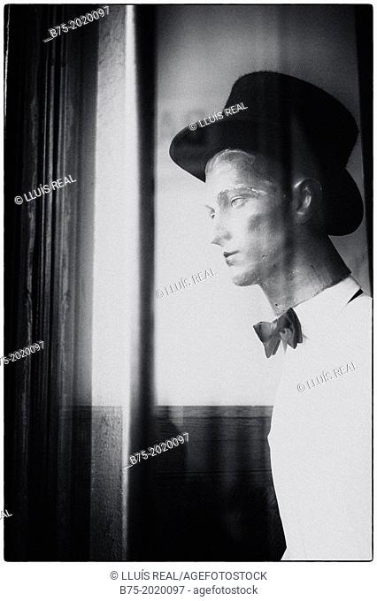 old male mannequin in a shop window of Bates hat shop in Rue de Rivoli, Paris, France