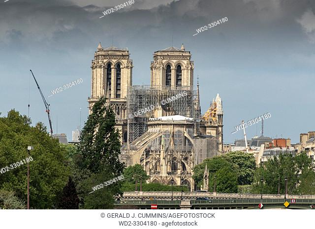 PARIS, FRANCE - 19 APRIL 2019 Notre Dame cathedral, after the timber roof caught fire. The melted scaffolding, constructed for the exact purpose of restoring...
